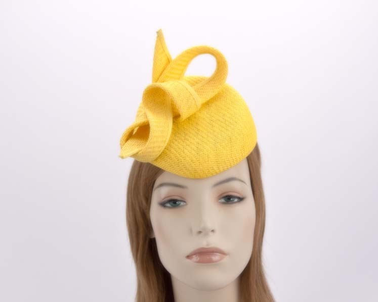 Yellow pillbox with bow